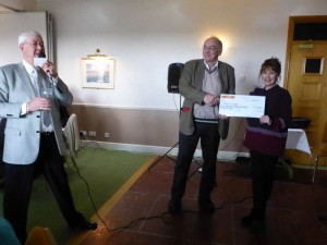 Pierre presenting a Cheque to Jan Francis
