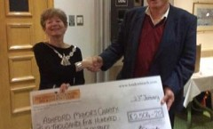 Ashford Mayor receiving charity donation from London Beach