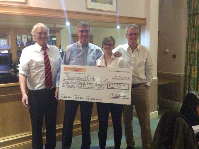Sisinghurst \cricket Club receiving a cheque from the London Beach Charity Scheme