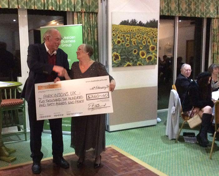 Rolvenden Football Club receiving a cheque